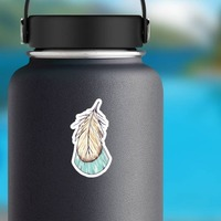 Blue and Tan Tail Feather Boho Sticker on a Water Bottle example