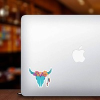Blue Skull with Feathers and Flowers Hippie Sticker on a Laptop example