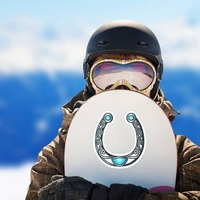 Cool Silver Horseshoe Cowboy Sticker on a Snowboard example