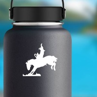 Cowboy Riding A Rodeo Bareback Bronco Sticker on a Water Bottle example