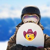Cowgirl Emoji Sticker on a Snowboard example