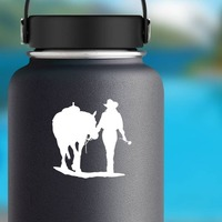 Cowgirl Walking Her Horse Holding A Rose Sticker on a Water Bottle example