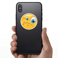 Crazy Confused Emoji Sticker on a Phone example