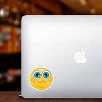Crazy Quivering Lip Emoji Sticker on a Laptop example