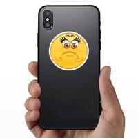 Crazy Sad Upset Emoji Sticker on a Phone example