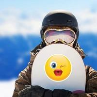Cute Blowing a Kiss Emoji Sticker on a Snowboard example