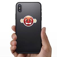 Cute Furious Emoji Sticker on a Phone example