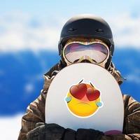 Cute Heartbroken Emoji Sticker on a Snowboard example
