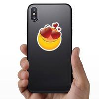 Cute In Love Emoji Sticker on a Phone example