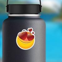 Cute In Love Emoji Sticker on a Water Bottle example