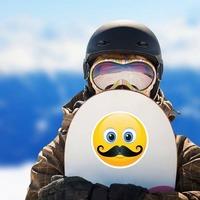 Cute Mustache Emoji Sticker on a Snowboard example