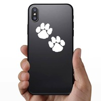 Cute Paw Prints Sticker on a Phone example