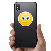 Cute Smile Emoji Sticker on a Phone example