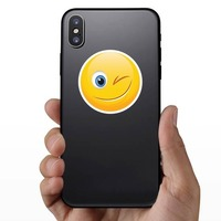 Cute Wink Emoji Sticker on a Phone example