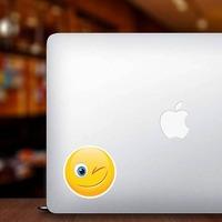 Cute Wink Emoji Sticker on a Laptop example
