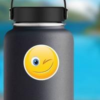 Cute Wink Emoji Sticker on a Water Bottle example