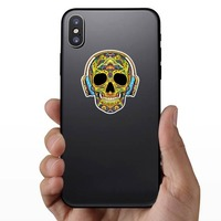Decorative Skull with Headphones On Sticker on a Phone example