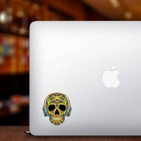 Decorative Skull with Headphones On Sticker on a Laptop example