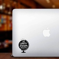 Explore Dream Discover Globe Sticker on a Laptop example