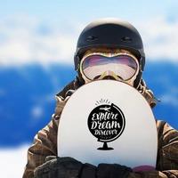 Explore Dream Discover Globe Sticker on a Snowboard example