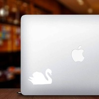 Gleaming Swan Sticker on a Laptop example