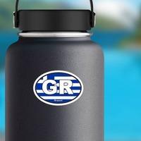 Greece Gr Flag Oval Sticker on a Water Bottle example