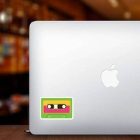 Green Cassette Tape Hippie Sticker on a Laptop example