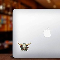 Guns And Roses Bull Cow Skull Sticker on a Laptop example