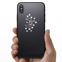 Half Moon Smiling Surrounded By Stars Sticker on a Phone example