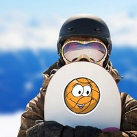 Happy Emoji Basketball Sticker on a Snowboard example