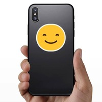 Happy Face Emoji Hippie Sticker on a Phone example