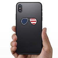 Joe Biden American Flag Sunglasses Sticker on a Phone example