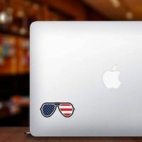 Joe Biden American Flag Sunglasses Sticker on a Laptop example