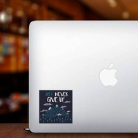 Just Never Give Up Square Sticker on a Laptop example