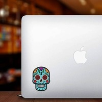 Keyhole Day of the Dead Skull Sticker on a Laptop example