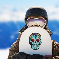 Keyhole Day of the Dead Skull Sticker on a Snowboard example