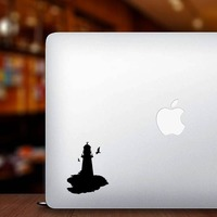 Lighthouse With Seagulls Sticker on a Laptop example