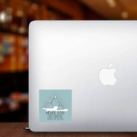 Never Stop Dreaming Square Sticker on a Laptop example