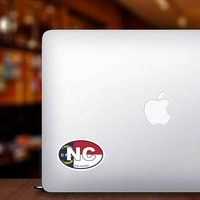 North Carolina Nc State Flag Oval Sticker on a Laptop example