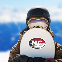 North Carolina Nc State Flag Oval Sticker on a Snowboard example