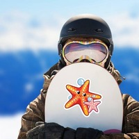 Orange and Pink Starfish Sticker on a Snowboard example