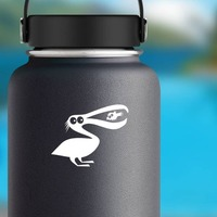 Pelican Eating Fish Sticker on a Water Bottle example