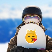 Phone Emoji Sticker Crown Blowing a Kiss on a Snowboard example