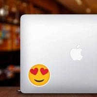 Phone Emoji Sticker Heart Eyes Happy on a Laptop example