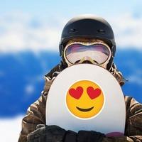 Phone Emoji Sticker Heart Eyes Happy on a Snowboard example