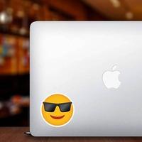 Phone Emoji Sticker Sunglasses on a Laptop example