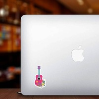 Pink Guitar with Flowers Hippie Sticker on a Laptop example