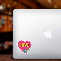 Pink Heart with Flowers Hippie Sticker on a Laptop example