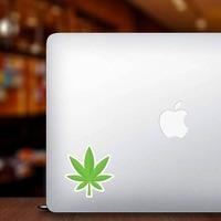 Pot Leaf Hippie Sticker on a Laptop example