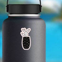 Prickly Cactus in Black Pot Sticker on a Water Bottle example